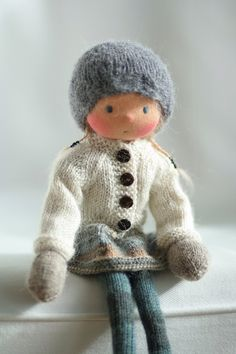 Handcrafted doll according to Waldorf pedagogy. The doll Kora is 14 (36 cm) long. Her head is sculpted in the traditional Waldorf style; the head is made of 100% cotton jersey from Netherlands.Her eyes and mouth are hand embroidered. Kora is a new style 14 knitted doll with a