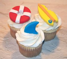 Hey, I found this really awesome Etsy listing at http://www.etsy.com/listing/120582777/fondant-cupcake-toppers-shark-fin-beach