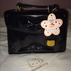 Hello Kitty - Black Purse Brand new with tags and dust bag. Prices are final and firm! Thanks!! Hello Kitty Bags Mini Bags
