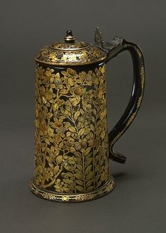 Tankard c1600-25. Kyoto, Japan (made). Wood covered with black and gold lacquer inlaid with mother-of -pearl.