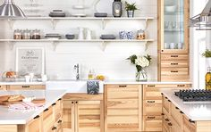 IKEA SEKTION kitchen system with ash cabinet doors and white countertop