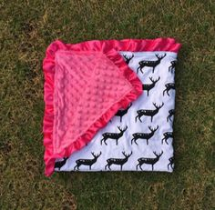 "Pink black deer minky blanket to mix and match with our adorable outfits. Measurements: 33"" x 31"" Material: Front: 100% cotton, Back: 100% pre-washed polyester"