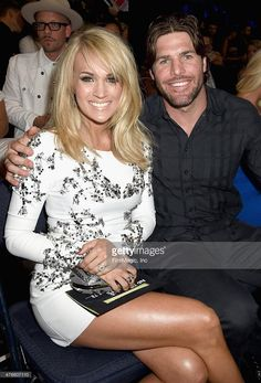 Mike Fisher and his wife, Carrie Underwood. Their son, Isaiah, is absolutely adorable and precious.