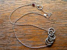 6 floating silver circles on silver chain w garnets by venicemama, $65.00