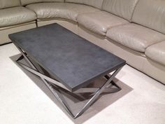 Concrete mobius coffee table with a stainless steel base. #Concrete Tables & Table Tops -Trueform Concrete Custom Work