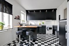 Modern black and white with checkered tile. #kitchen #kitchendesign #kitchenremodel