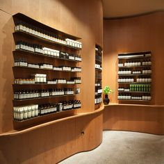 In Praise of Shadows creates undulating wooden walls for Stockholm Aesop store