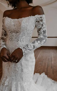 Romantic Lace mermaid wedding dress with long sleeves and off the shoulder neckline | Essense of Australia Wedding Dresses Spring 2020 - Belle The Magazine | See more gorgeous bridal gowns by clicking on the photo