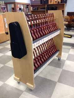 This is a PDF file that includes the dimensions for a homemade ukulele cart for 30 instruments. Measurements have been marked on photographs taken of the finished product as well as a short walkthrough of steps taken to build it. Also added in version 1.3 ...