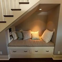 reading spot in the nook under the stairs - Click image to find more Home Decor Pinterest pins