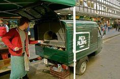 Cool mobile pizza oven built on a vintage mini 3-wheel Italian Piaggio Ape delivery vehicle.