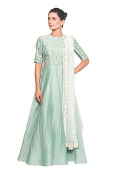 A gorgeous glass bead leaf motif adorns the bodice of this seafoam-hued open-backed anarkali suit. #Indianfashion