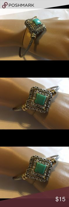 """Beautiful Cable Bangle Bracelet 2.25ctw Two Tone Beautifully Created Fine Turquoise and White Sapphire Cable Bangle Bracelet. Alloy Metal. Fits 6-7.5"""" wrist. The first four photos are stock photos gotten online. The others are of the actual piece. Jewelry Bracelets"""