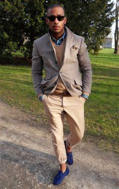 Wear a brown blazer with beige chinos if you're going for a neat, stylish look. Feeling inventive? Complement your outfit with navy suede tassel loafers.  Shop this look for $349:  http://lookastic.com/men/looks/sunglasses-denim-shirt-cable-sweater-blazer-belt-chinos-tassel-loafers-pocket-square/4593  — Black Sunglasses  — Blue Denim Shirt  — Brown Cable Sweater  — Brown Blazer  — Dark Brown Leather Belt  — Beige Chinos  — Navy Suede Tassel Loafers  — White and Brown Pocket Square
