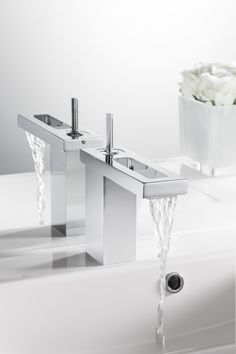 This design is confidently artistic with a whisper of hotel boutique - KH ZERO 4 Basin Monobloc Bathroom Tap from Kelly Hoppen