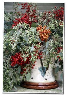 A Swedish majolica vase overflowing with eucalyptus and pepper berries…