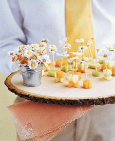 decorate your appetizer toothpicks with mini daisies. Grab a package of mini daisies and a glue gun.