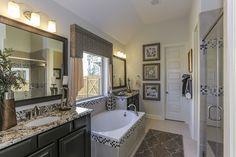 Gehan Homes Master Bathroom - Dark wood cabinets, drop in tub, granite countertop, gray accents, white walls. Houston, Texas   Inverness Estates Premier - Mahogany #Gehanhomes