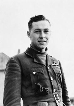 """P/O William L """"Willie"""" McKnight of No 242 Squadron RAF poses for the camera at RAF Coltishall in September 1940. Between May and November, the 21-year-old pilot claimed 16 and 2 shared destroyed and 3 probables in combats over France and Britain, becoming the first Canadian ace. He had a half skeleton and sickle painted on both sides of the fuselage of Hurricane Mk I LE-A."""