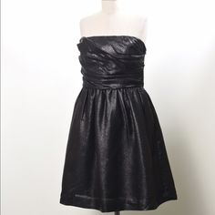 """J.Crew COLLECTION metallic strapless party dress PRICE IS FIRM I DO NOT TRADE Gorgeous classic """"little black dress"""".  Strapless bustier from J. Crew Collection; New with Tags, Top of dress has structured ruching with a high waist line and flares into skirt at the bottom. Good for cocktail parties or date nights.  Metallic black silk blend taffeta type face fabric. Size 6.  Bust: 33"""" Waist: 28"""" Hip: Flare Length from Bust: 29"""" J.Crew COLLECTION Dresses Strapless"""