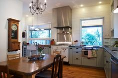 floor, colored cabinets, white walls