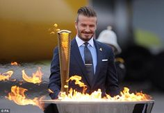 David Beckham lights the Olympic Torch - Olympics Games 2012 London Trending Hairstyles For Men, Haircuts For Men, Men's Haircuts, Slick Back Undercut, London Tumblr, Olympic Flame, Baptism Candle, 2012 Summer Olympics, Devon And Cornwall