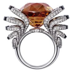LOdyssée de Cartier high jewellery ring in white gold, set with a 33.42ct brown tourmaline, obsidian and diamonds.