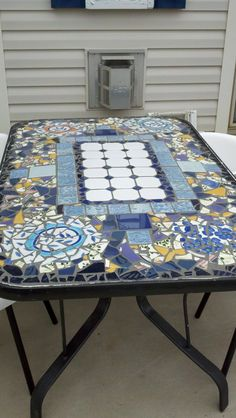 Patio Table Rebuilt From Recycled Plates And Tiles.