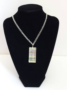 A clear glass tile with added colour makes for a vividly detailed pendant. Add it to your ensemble today for a touch of sophisticated flair. Glass Pendants, Dog Tags, Clear Glass, Dog Tag Necklace, Tile, Touch, Colour, How To Make, Jewelry