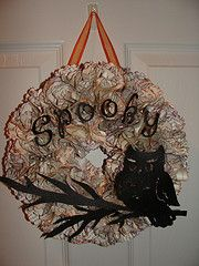 Spooky Halloween Wreath inspired by Pinterest,made with a dollar store book, 3 inch scalloped punch, ink pads (purple & orange), Cricut letters #halloween #spooky #wreath