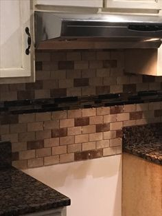 Backsplash with Baltic brown counter tops and white cabinets. We are loving it