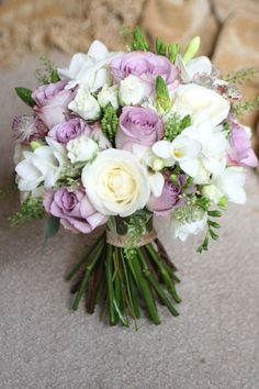 Vintage style bouquet with roses, freesia, spray roses, ornithogalum, thlespi and eucalyptus.