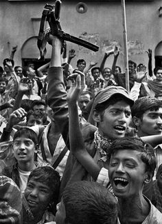 Muktijoddha (freedom fighters) and civilian are celebrating the victory of Bangladesh in the liberation war against Pakistan. Bangladesh, December (1971)   Photographer- Raghu Rai. from - Bangladesh Old Photo Archive's FB page