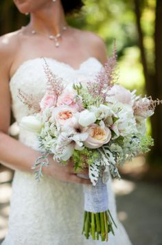 Bridal Bouquet - Designed with Peonies, Ranunculus, Roses, Spider Mums, Hydrangea, Tulips, Queen Anne's Lace, Astilbe, Alstromeria, Dusty Miller, and more! Broach attached to lace-wrapped handle