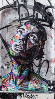 Vibrant portrait pasteups by London street artist Ant Carver.