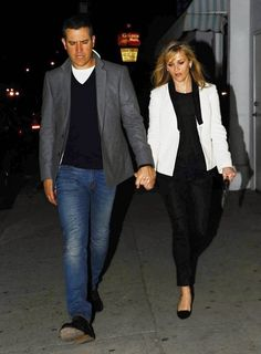 Reese Witherspoon and Jim Toth walk hand in hand while enjoying a night out in Los Angeles, California on February 27, 2015.