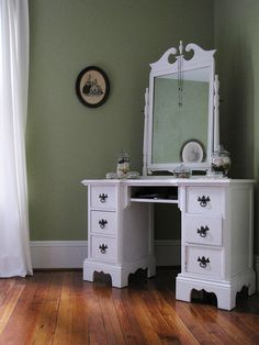 Remake something like this with a thrifted desk and a decorative mirror.