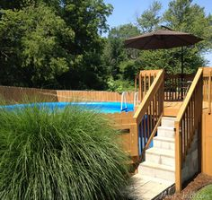 Lovely landscaping around above ground pool