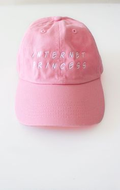 - Description Details: Pink six panel cap with 'Internet Princess' embroidery & adjustable back with tri-glide buckle. Brand: NYCT Clothing. 100% Chino Twill. Imported. All accessories are final sale.