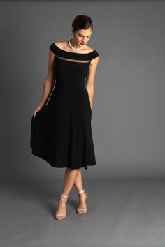 The definitive Audrey Hepburn dress. A gentle a line skirt with a very flattering boat neckline and dropped waist. Looks great on so many figures. Shown here in Black. Also available in Red. Sizing corresponds to Australian standard sizing as follows:XS: 6-8S: 8-10M: 10-12L: 12-14XL: 14-16