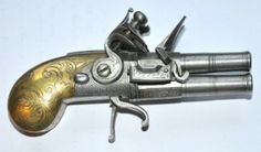 A double-barreled flintlock pocket pistol from 1740 is included in  'Antique Guns from the Collection of the Liège Arms Museum,' at the National Ornamental Metal Museum through June 19.