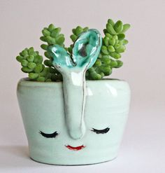 Ice soft pale green smiling vase with green flower by CasaAbril
