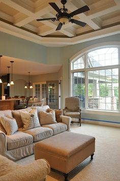Benjamin Moore Palladian Blue - I love these colors for a large living space.  Light blue walls with neutral couch  Love the open concept and so much natural light!