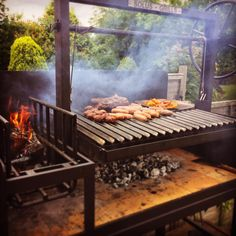 Traditional Argentine bbq grills: For homes, restaurants and caterers. All hand made in the UK, to our customer requirements. Grill Restaurant, Restaurant En Plein Air, Outdoor Restaurant, Outdoor Grill Station, Outdoor Cooking Area, Outdoor Kitchen Bars, Outdoor Kitchens, Argentinian Bbq, Argentine Grill
