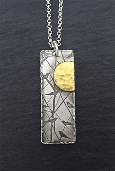 Sterling silver and gold pendant featuring birds playing in the trees and a beautiful golden sun! #jewelry