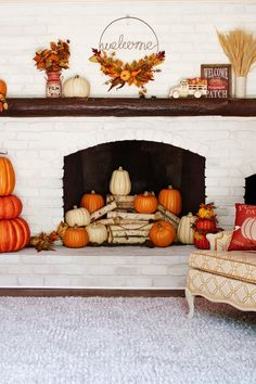 Bright colored pumpkins welcome guests when placed in your home or on your porch! #halloween #fall #lowes #fireplace