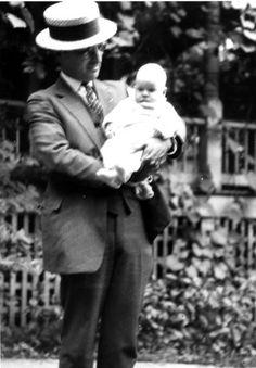 Harry S. Truman Holding Baby Margaret Truman
