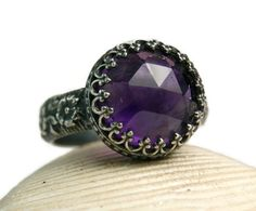 This listing is for a handmade .925 sterling silver natural Amethyst ring. I handcrafted this ring out of a sheet of sterling silver and