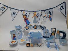 Linda decoração de aniversário no tema Frozen, uma aventura congelante! <br> <br>Kit Scrap Festa, produzido em papéis de alta gramatura, com apliques de pedraria e fitas de cetim. <br> <br>O kit contém: <br>- bandeirola com o nome da criança (6 bandeiras, caso deseje mais favor consultar) <br>- 12 topper grande para enfeite de mesa, sendo: <br>- 4 da Ana <br>-4 da Elsa <br>-4 do Olaf <br>-4 cachepos para enfeite de mesa <br>-10 potinhos descartáveis com doille decorado Ana <br>-10 potinhos…