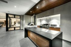 France and son loves this kitchen, the black kitchen islander with natural wood drawers gives the white kitchen a little twist.